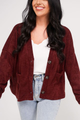 Close Up of a model wearing the Cropped Cardigan Sweater in Burgundy