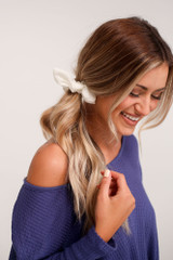 Model wearing the White Tie Scrunchie from Dress Up