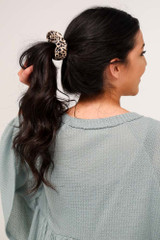 Dress Up model wearing the Leopard Scrunchie in a ponytail