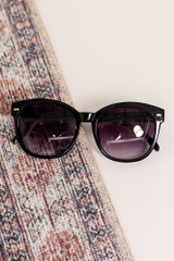 Flat Lay of the Horn Rimmed Sunglasses in Black