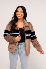 Dress Up model wearing the Striped Faux Fur Jacket with light wash jeans