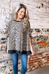 Model wearing the Brushed Knit Poncho with jeans