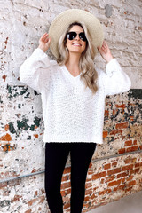Model wearing the Oversized Popcorn Knit Top in Ivory