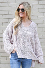 Dress Up model wearing the Oversized Popcorn Knit Top in Blush
