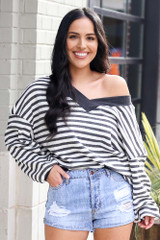 Charcoal - Model wearing the Striped Waffle Knit Oversized Top with denim shorts