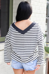 Model wearing the Striped Waffle Knit Oversized Top with denim shorts Back View