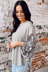 Taupe - Dress Up model wearing the Snakeskin Sleeve Oversized Top tucked into jeans