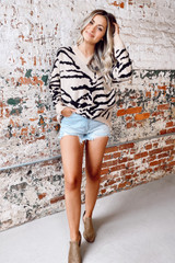 Model wearing the Tiger Print Brushed Knit Top