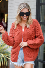 Pom Pom Heart Knit Cardigan in Rust from ShopDressUp