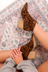 Model wearing the Leopard Microsuede Block Heel Booties Sitting View