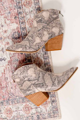 Flat Lay of Snake Microsuede Block Heel Booties on oriental rug Side View from Dress Up Boutique