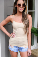 Model wearing the Basic Tank in Taupe with light wash distressed denim shorts