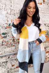 Model wearing the Color Block Knit Cardigan with a white tank and light wash jeans Front View