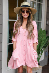 Model wearing the Blush Button Front Babydoll Dress with wide brim fedora and sunglasses from Dress Up Boutique