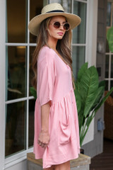 Model wearing the Blush Button Front Babydoll Dress with wide brim fedora and sunglasses from Dress Up Boutique Side View