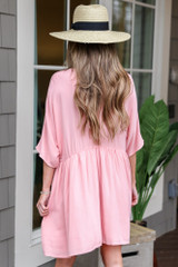 Model wearing the Blush Button Front Babydoll Dress with wide brim fedora and sunglasses from Dress Up Boutique Back View