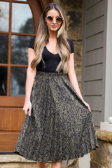 Model wearing the Leopard Pleated Midi Skirt in Olive