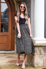 Dress Up model wearing the Leopard Pleated Midi Skirt with nude heels and a black bodysuit