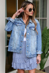 Model wearing the Distressed Denim Jacket