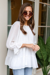 Model wearing the Swiss Dot Tiered Babydoll Tunic with circular sunglasses