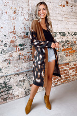 Model wearing the Leopard Lightweight Knit Cardigan with black lace tank top, denim shorts, and block heel booties from Dress Up Front View