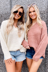Blush - Model wearing the Oversized Knit Top in Blush with high rise denim shorts from Dress Up Front View
