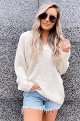 Model wearing the Oversized Knit Top in Ivory
