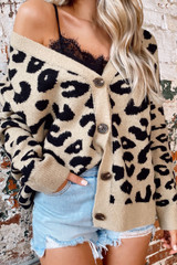 Model wearing the Leopard Luxe Knit Sweater Cardigan with black lace tank and denim shorts from Dress Up