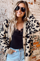 Model wearing the Leopard Luxe Knit Sweater Cardigan with black lace tank and denim shorts from Dress Up Open Front View