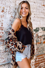 Model wearing the Leopard Lightweight Knit Cardigan with high rise jean shorts and ankle booties from Dress Up