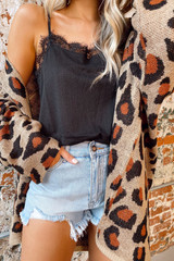Model wearing the Leopard Lightweight Knit Cardigan with high rise jean shorts from Dress Up Boutique Front View