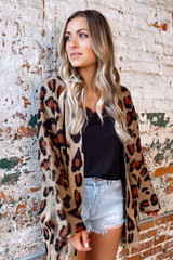 Model wearing the Leopard Lightweight Knit Cardigan with high rise jean shorts and a black lace tank from Dress Up Boutique