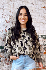 Model wearing the Camo Luxe Knit Top tucked into high rise mom shorts from Dress Up Front  View