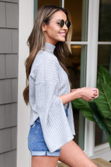 Model wearing the Grey Mock Neck Statement Sleeve Top from Dress Up Side View