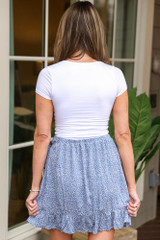 Model wearing the Floral Wrap Skirt in Blue with white tee from Dress Up Back View