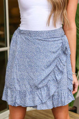 Model wearing the Floral Wrap Skirt in Blue with white tee from Dress Up Close Up View