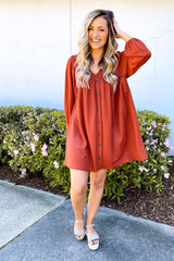 Model wearing the V-Neck Button Front Babydoll Dress in Rust with platform espadrilles