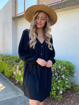 Model wearing the V-Neck Button Front Babydoll Dress in Black