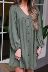 Close Up of the V-Neck Button Front Babydoll Dress in Olive