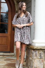 Dress Up model wearing the Leopard V-Neck Babydoll Dress with taupe booties