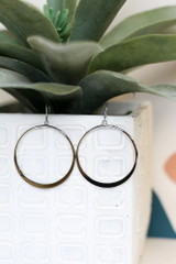 Close Up of the Drop Hoop Earrings in Silver