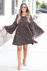 Model wearing the Floral Bell Sleeve Babydoll Dress with nude heels