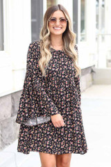Model wearing the Floral Bell Sleeve Babydoll Dress Front View