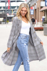 Model wearing the Grey Plaid Longline Blazer with high rise distressed jeans Side View