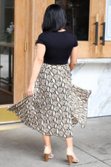 Model from Dress Up wearing the Snakeskin Pleated Midi Skirt with black bodysuit Side View