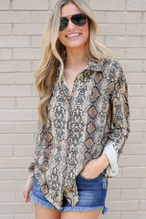 Dress Up model wearing the Snakeskin Button Up Blouse with denim shorts