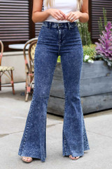 Model wearing the Dark Wash High-Rise Acid Washed Flare Jeans Close Up