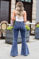 Model wearing the Dark Wash High-Rise Acid Washed Flare Jeans Back View