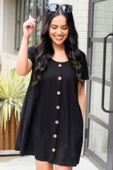 Model wearing the Button Front Dress in Black