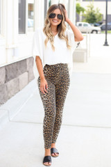 Model wearing the High-Rise Leopard Skinny Jeans with black bodysuit Close Up